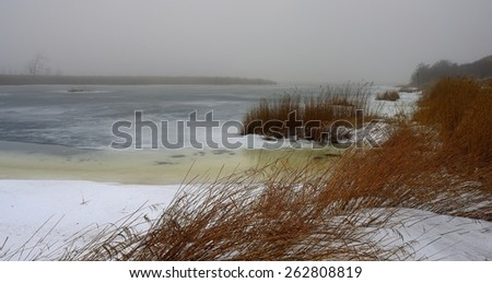 This is icy lake in Caucasus landscape in winter - stock photo