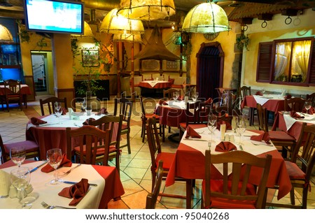 This is Italian restaurant with a traditional interior - stock photo