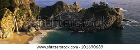 This is Julia Pfeifer Burns State Park. It shows McWay Cove with an 80 ft. waterfall spilling onto the beach and into the Pacific Ocean. - stock photo