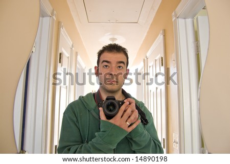 This is me - my self portrait.  I faced the curvy mirror at the end of the hallway.  Backlit lighting coming from the other end of the house. - stock photo