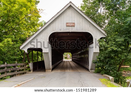 This is one of the many covered bridges that can be seen in Vermont. - stock photo