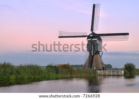This is one of the more than 1000 windmills still available in The Netherlands. Its' name is Gelkenes Windmill.