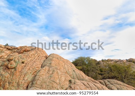 This is one of the numerous granite boulders of the Granite Dells, a popular climbing and hiking area in Prescott, AZ - stock photo