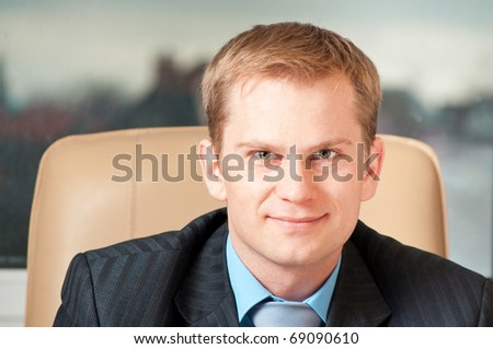 This is portrait of a smiling businessman - stock photo