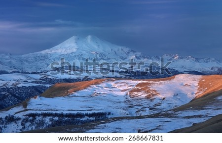 This is somber morning in Caucasus mountains ,Elbrus in winter - stock photo
