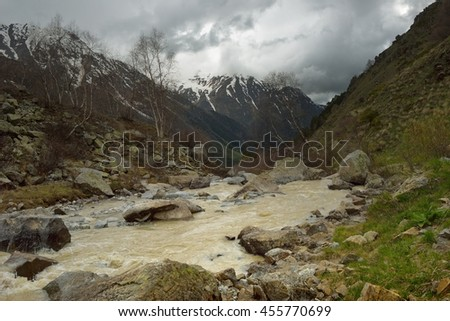This is somber valley in Caucasus mountains in spring - stock photo
