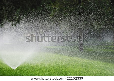 This is sprinkling machine in the garden - stock photo