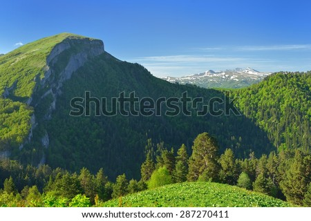 This is sunny morning in Caucasus mountains in summer