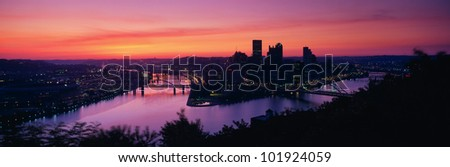 This is sunrise on the Allegheny and Monongahela Rivers where they meet the Ohio River. - stock photo