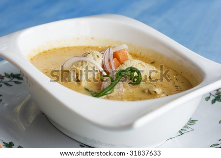 This is Thai Green Curry.  It's a coconut based curry and a signature dish of Thailand. - stock photo