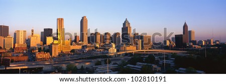 This is the Atlanta skyline at sunset. - stock photo