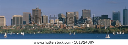 This is the Charles River with sailboats and the State Capitol on a fall day. - stock photo