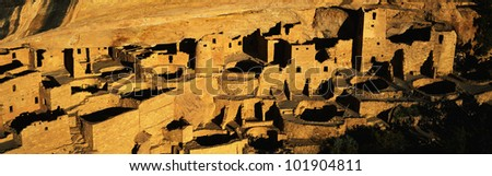 This is the Cliff Palace in the Anasazi Indian Ruins. They lived from 1100-1300AD as cliff dwellers. There is sunset light on the Cliff Palace. - stock photo