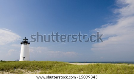 This is the Edgar Harbor Light House Martha's vineyard with Beach - stock photo