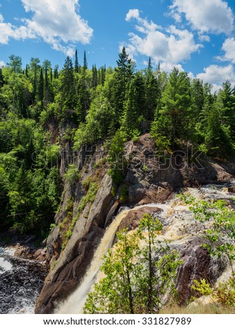 This is the edge of the High Falls of Baptism River at Tettegouche State Park. This is in the Lake Superior North Shore area in Minnesota. - stock photo