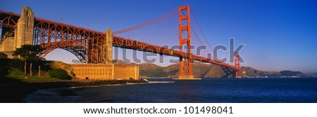 This is the Golden Gate Bridge with Marin County on the right. - stock photo
