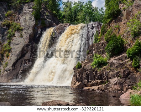 This is the High Falls of Baptism River at Tettegouche State Park. This is in the Lake Superior North Shore area in Minnesota. - stock photo