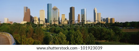 This is the Houston skyline with Memorial Park in the foreground. It is in afternoon light. - stock photo