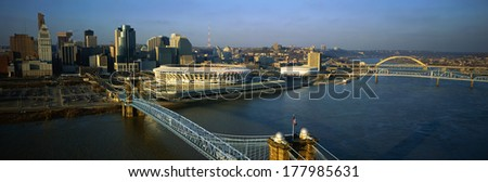 This is the Ohio River with the Roebling Suspension Bridge over it. At the end of the bridge is Three Rivers Stadium and the Cincinnati skyline. - stock photo