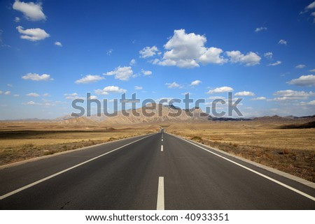 This is the road in autumn of Inner Mongolia, China. - stock photo