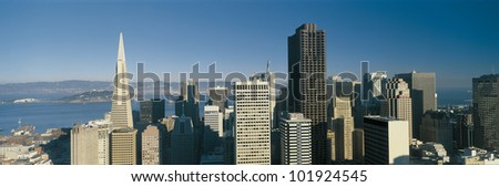 This is the San Francisco skyline in daylight. The Bay Bridge is very small in the background. - stock photo