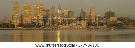This is the skyline view from Camden, New Jersey. It shows sunrise on the river. - stock photo