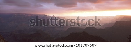 This is the south rim of the Grand Canyon known as Grand View Point.  Also in view is the Colorado River at sunrise. - stock photo