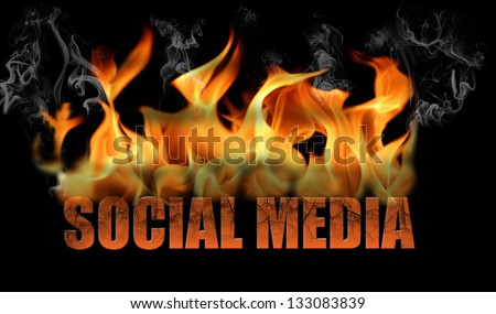 This is the words social media in flames, with fire and smoke and steam coming off.  It is horizontal on a black background.