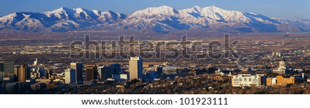 This is Utah's State Capitol with the Great Salt Lake and snow capped Wasatch Mountains in morning light. - stock photo