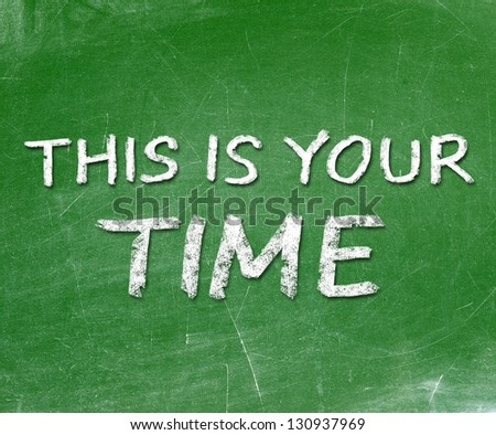 This is your time handwritten chalk on a blackboard - stock photo