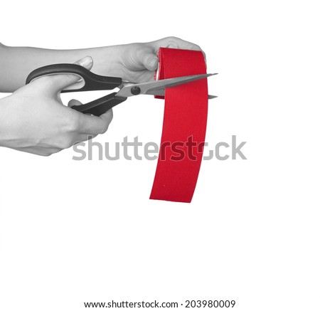 "This kind of taping is called ""Kinesiotape"". Its purpose is to detonisize the muscle to reduce pain. In some cases you can also tonisize the muscle. - stock photo"