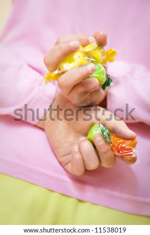 this little girl has stolen some sweets - stock photo