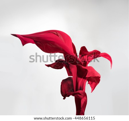 This magnificent flower is made from pieces of flying in the wind satin fabric - stock photo