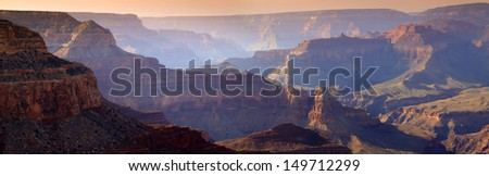 This majestic sunset photo at the South Rim of the Grand Canyon captures the amazing layers of landscape and quality of light. - stock photo