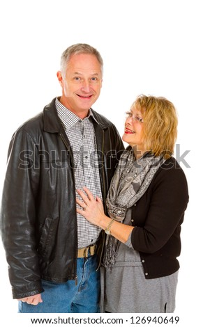This man and woman look very healthy and in love against an isolated white background in studio.