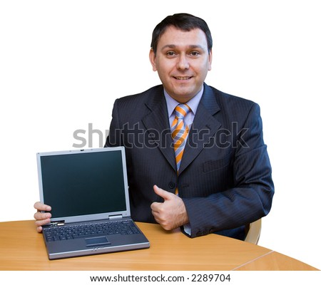 This man can sell anything! (on his laptop) - stock photo