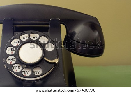 This old phone, though a bit ratty, still has tons of character and charm from the analogue days. - stock photo