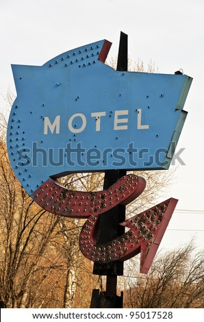 This old, rusty, faded motel sign must have been quite nice when it was new. - stock photo
