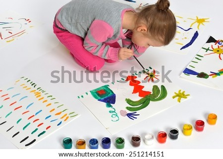 This painting is for my mummy. Little girl is drawing on paper.   - stock photo