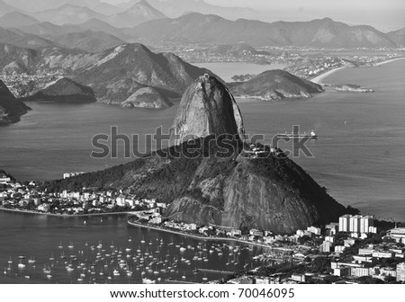this photo is of Rio de Janeiro.  The photo overlooks the city with Sugar Loaf shown prominently in the background and was taken from Corcovado. - stock photo