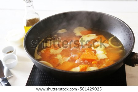 This photo of  food preparation in a pan