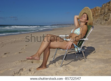 This photo shows a beautiful young lady on the beach.