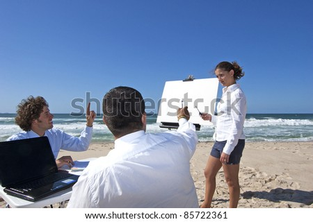 This photo shows a business meeting on the beach.