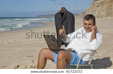 This photo shows a business men (Ricardo), working with a laptop on the beach !