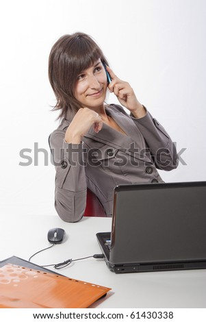 This photo shows a business woman at work thinking about good things !