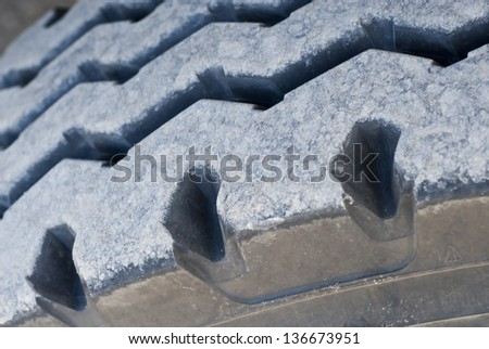 This photo shows a close up of a truck tyre.
