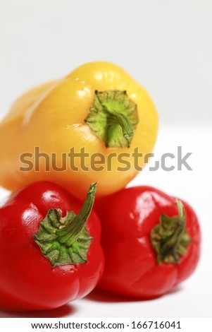 This photo shows a closeup with some pepers, red and yelow.