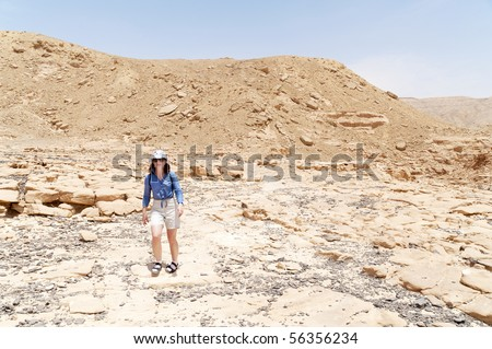 this photo shows a girl tourist in desert - stock photo