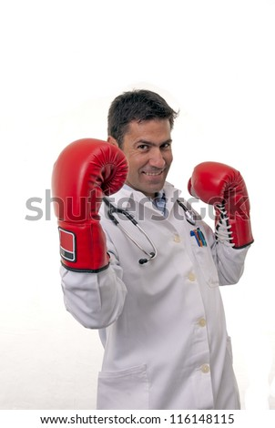 This photo shows a young doctor wearing boxing gloves doing an uppercut,  isolated on white background.