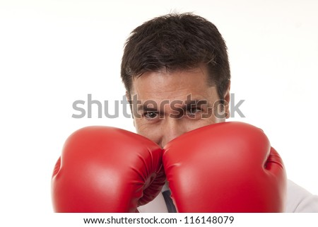 This photo shows a young doctor wearing boxing gloves on a defense position, isolated on white background.